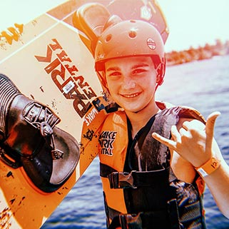Image of Boy Holding a Wakeboard